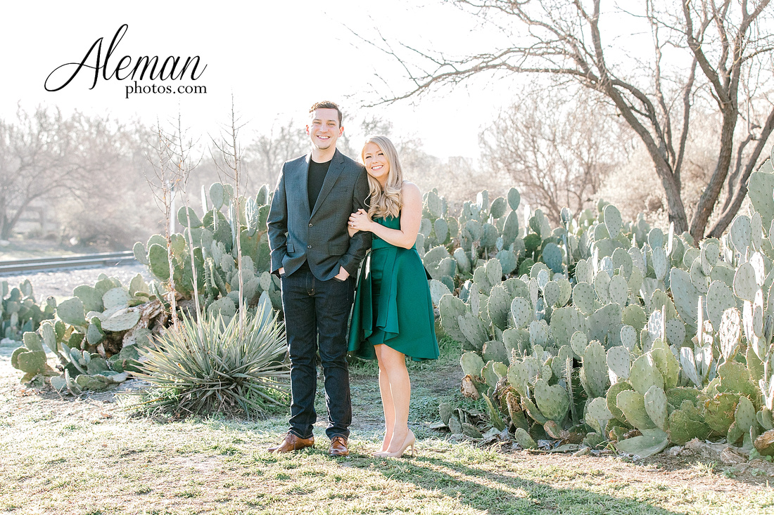 fort-worth-stockyards-engagement-dogs-rustic-winter-green-dress-formal-goldendoodle-aleman-photos-004