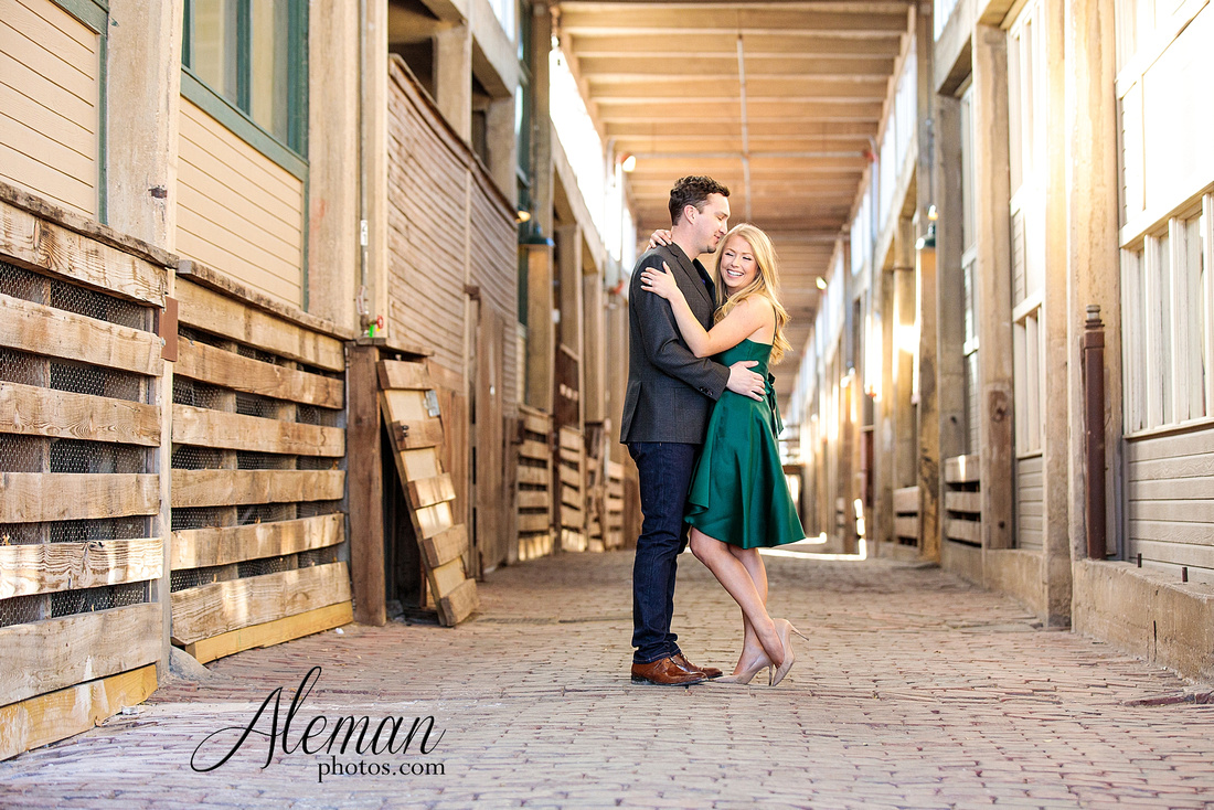 fort-worth-stockyards-engagement-dogs-rustic-winter-green-dress-formal-goldendoodle-aleman-photos-009