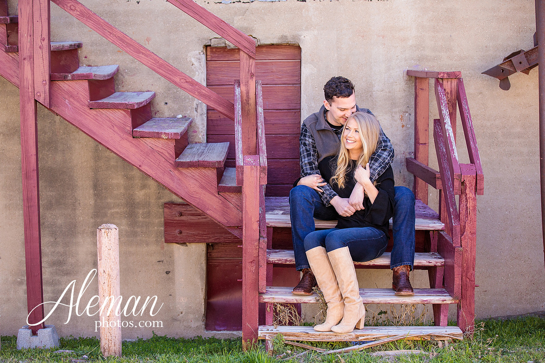 fort-worth-stockyards-engagement-dogs-rustic-winter-green-dress-formal-goldendoodle-aleman-photos-013