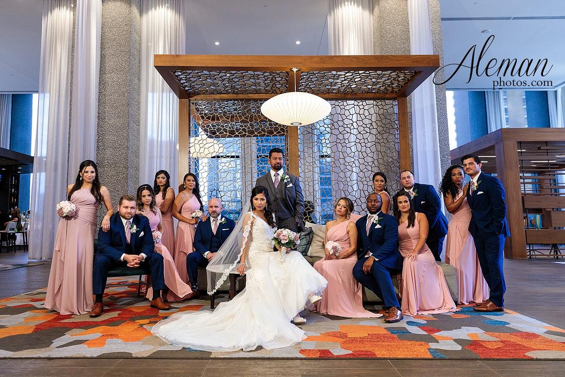 st-joseph-catholic-church-arlington-wedding-dallas-westin-downtown-urban-city-cityscape-el-fenix-pink-bridesmaid-dresses-gray-suit-navy-suit-fake-flowers-aleman-photos-mercedes-ian-007