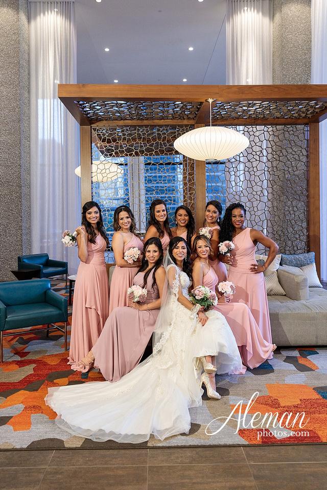 st-joseph-catholic-church-arlington-wedding-dallas-westin-downtown-urban-city-cityscape-el-fenix-pink-bridesmaid-dresses-gray-suit-navy-suit-fake-flowers-aleman-photos-mercedes-ian-008