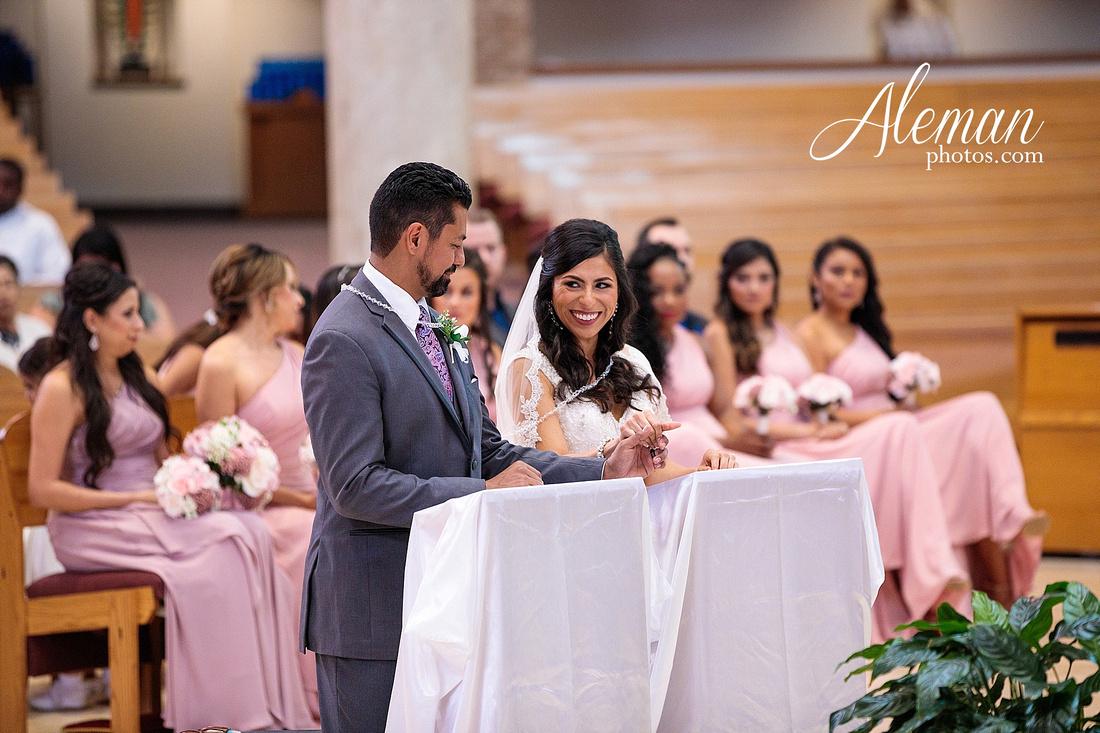 st-joseph-catholic-church-arlington-wedding-dallas-westin-downtown-urban-city-cityscape-el-fenix-pink-bridesmaid-dresses-gray-suit-navy-suit-fake-flowers-aleman-photos-mercedes-ian-034