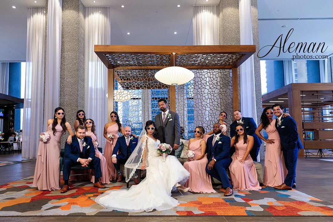 st-joseph-catholic-church-arlington-wedding-dallas-westin-downtown-urban-city-cityscape-el-fenix-pink-bridesmaid-dresses-gray-suit-navy-suit-fake-flowers-aleman-photos-mercedes-ian-044