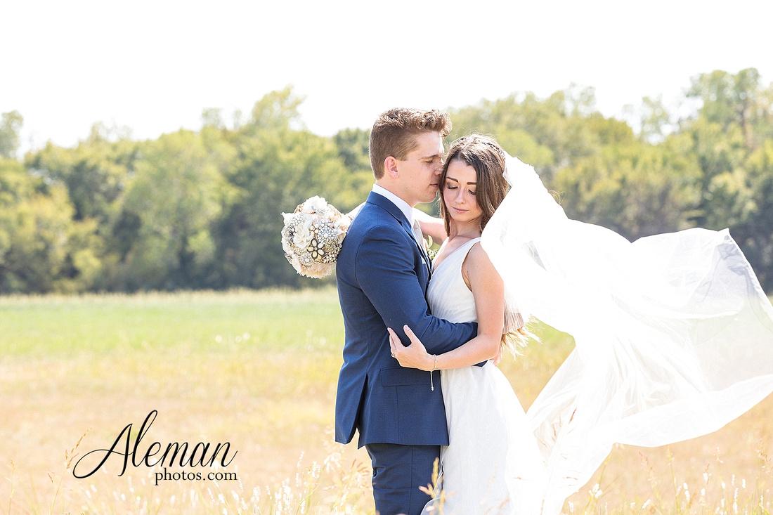 outdoor-field-bohemian-vera-wang-dress-rustic-wedding-grace-church-ovilla-wine-dark-red-bridesmaid-dresses-navy-suits-groom-tall-grass-aleman-photos-kaitlin-jason-003